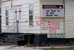 10 December, 05.  New Orleans, Louisiana. Post Katrina aftermath. <br />  Signs outside the Good News Baptist Church in Gentilly. <br /> Photo; &copy;Charlie Varley/varleypix.com