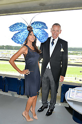 JACKIE ST.CLAIR and CARL MICHAELSON at the first day of the 2014 Royal Ascot Racing Festival, Ascot Racecourse, Ascot, Berkshire on 17th June 2014.