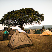 Tents at dusk at the Simba Campsite on the rim of Ngorongoro Crater in the Ngorongoro Conservation Area, part of Tanzania's northern circuit of national parks and nature preserves.
