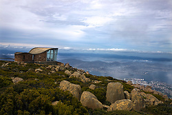 Enclosed observation room overlooks the edge at the summit of Mount Wellington, with Hobart, Tasmania, Australia down below.