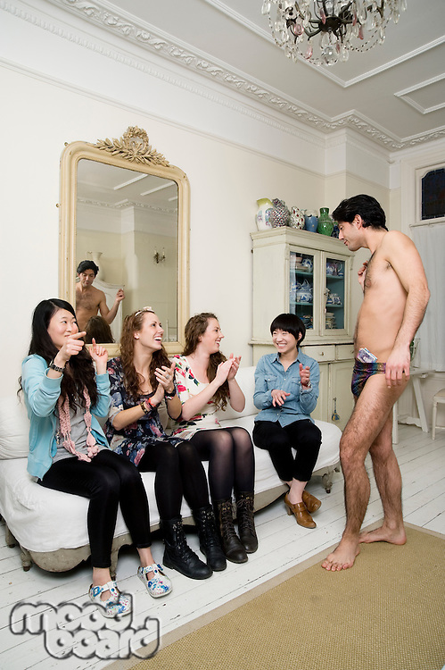 Young females enjoying male stripper