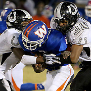Whiteville's Nate Powell is tackled by South Columbus' Khalil Soles, left and Dashaun Daniels. (Jason A. Frizzelle)