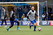 AFC Wimbledon defender Barry Fuller (2) and AFC Wimbledon defender Deji Oshilaja (4) warming up during the The FA Cup match between AFC Wimbledon and Charlton Athletic at the Cherry Red Records Stadium, Kingston, England on 3 December 2017. Photo by Matthew Redman.