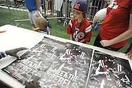 "Hiram Eastland IV gets posters signed at ""Meet The Rebels"" at the Manning Center in Oxford, Miss. on Saturday, August 16, 2014. Members of the Ole Miss football, soccer, volleyball, rifle, and women's golf teams, as well as the spirit squads, greeted fans and signed autographs."