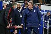 Cardiff City First Team Manager Neil Warnock greets Manchester United interim Manager Ole Gunnar Solskjaer and Michael Carrick during the Premier League match between Cardiff City and Manchester United at the Cardiff City Stadium, Cardiff, Wales on 22 December 2018.
