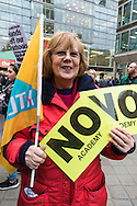 A woman's placards say &quot;NO ACADEMY&quot; as teachers gather  in Westminster, London for a march against education secretary Nicky Morgan's proposal that all schools are turned into academies.<br /> Picture by Paul Davey/Focus Images Ltd +447966 016296<br /> 23/03/2016