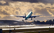 A new 777 takes off from Paine Field on a test flight during a break between rainstorms over Everett. (Mike Siegel / The Seattle Times, 2018)