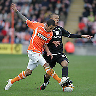 Blackpool - Saturday March 7th, 2009: DJ Cambell of Blackpool and Ryan Bertrand of Norwich City in action during the Coca Cola Championship match at Bloomfield Road, Blackpool. (Pic by Michael Sedgwick/Focus Images)