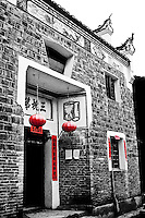 Red lanterns adorn ancient buildings in the streets of Liuli village in Guizhou province, China.