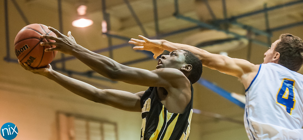 Concord's Daniel Spencer goes up for a shot against Mount Pleasant's Austin Parker Monday night at Mount Pleasant High School. The Spiders won the game 85-40.