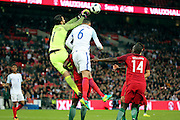 Portugal goalkeeper, Rui Patricio (01) beating England defender, Chris Smalling (06) to the ball during the Friendly International match between England and Portugal at Wembley Stadium, London, England on 2 June 2016. Photo by Matthew Redman.
