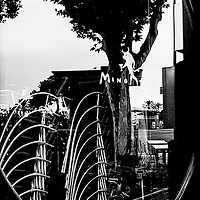 I shot this image of a restaurant window in Spain. It really speaks to the traditional black and white style of photographic fine art. I love the 'layers' and reflections we have in the image.