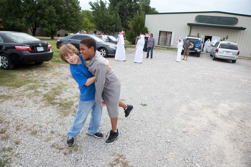 Khalil hugs his best friend Kai Weekley after services at Pittsburg Masjid on August 30, 2011. Kai lives over an hour away from Khalil in Ft. Scott, Kansas, so the mosque provides a halfway point where their two families can meet.