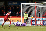 Crawley Town Goalkeeper Paul Jones makes a save at full stretch to keep his side level at 0-0 during the Sky Bet League 2 match between Crawley Town and Plymouth Argyle at the Checkatrade.com Stadium, Crawley, England on 20 February 2016. Photo by David Charbit.