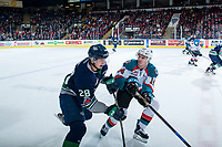 KELOWNA, CANADA - JANUARY 5: Wil Kushniryk #14 of the Kelowna Rockets checks Samuel Huo #28 of the Seattle Thunderbirds during first period on January 5, 2017 at Prospera Place in Kelowna, British Columbia, Canada.  (Photo by Marissa Baecker/Shoot the Breeze)  *** Local Caption ***