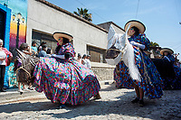 Ajijic, Jalisco State, Mexico. 13 February, 2018. Mardi Gras Festival and Parade, Traditionally dressed on pretend horses pass by. Peter Llewellyn/Alamy Live News