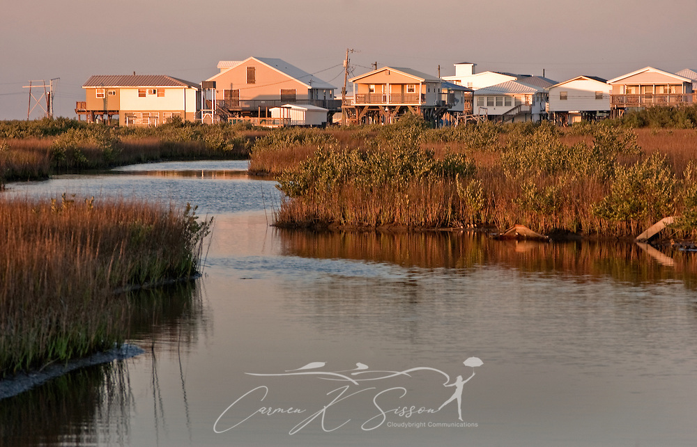 The sun sets on a row of houses along Louisiana Highway 1 on March 6, 2011 in Grand Isle, La. The island was heavily impacted by the Deepwater Horizon oil spill April 20, 2010 and continues to recover. (Photo by Carmen K. Sisson)
