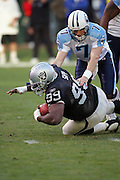 OAKLAND, CA - DECEMBER 19:  Warren Sapp #99 of the Oakland Raiders recovers a fourth quarter fumble by quarterback Billy Volek #7 of the Tennessee Titans (the fumble was caused by teammate Tommy Kelly) at Network Associates Coliseum on December 19, 2004 in Oakland, California. The Raiders defeated the Titans 40-35. ©Paul Anthony Spinelli *** Local Caption *** Warren Sapp;Billy Volek