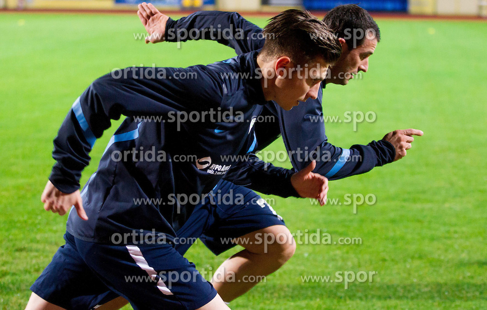 Rok Elsner and Mirnes Sisic during practice session of Slovenian National football team prior to the friendly match against Former Yugoslav republic of Macedonia on November 12, 2012 in Domzale, Slovenia. (Photo By Vid Ponikvar / Sportida)