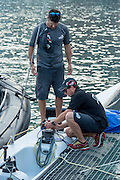 Emirates Team New Zealand's Jeremey Lomas and Dylan Ewing put the extreme 40 to bed after racing on day three of the Extreme Sailing Series Regatta at Nice. 4/10/2014