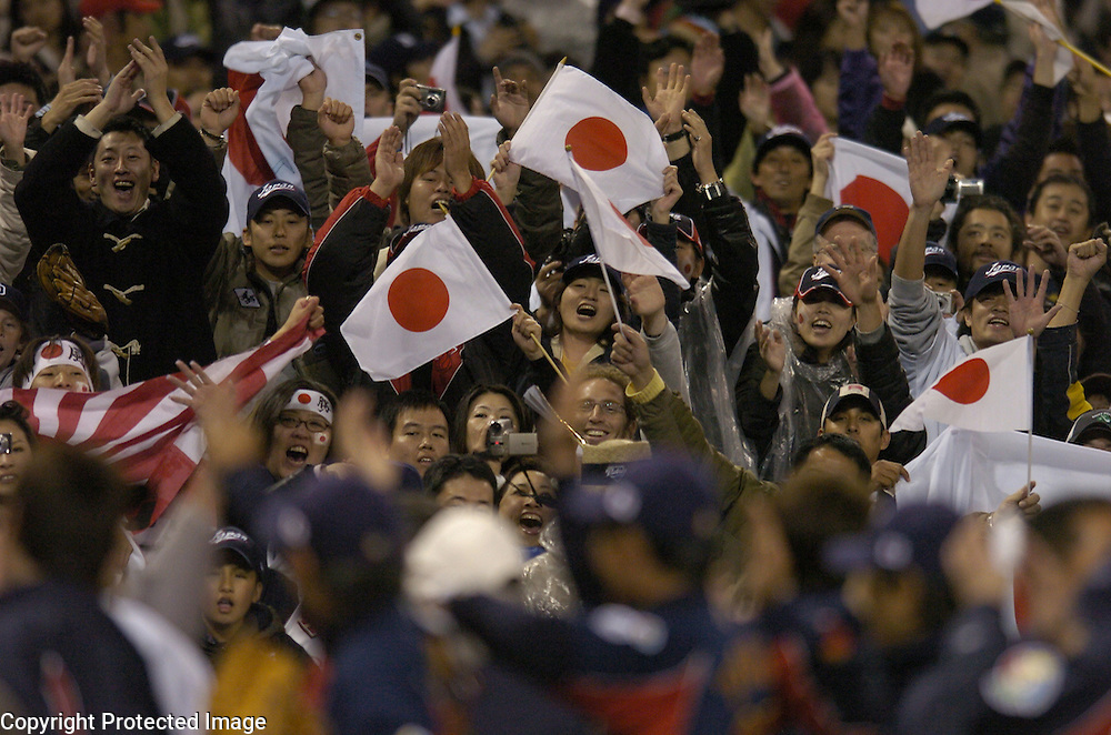 Team Japan fans celebrate after Japan beat Team Korea 6-0 in Semi-Final action of the World Baseball Classic at PETCO Park, San Diego, CA.