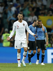 (L-R) Cristiano Ronaldo of Portugal, Diego Godin of Uruguay, Cristhian Stuani of Uruguay during the 2018 FIFA World Cup Russia round of 16 match between Uruguay and at the Fisht Stadium on June 30, 2018 in Sochi, Russia