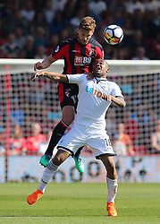 Swansea City's Jordan Ayew and Bournemouth's Simon Francis (left) challenge for a header