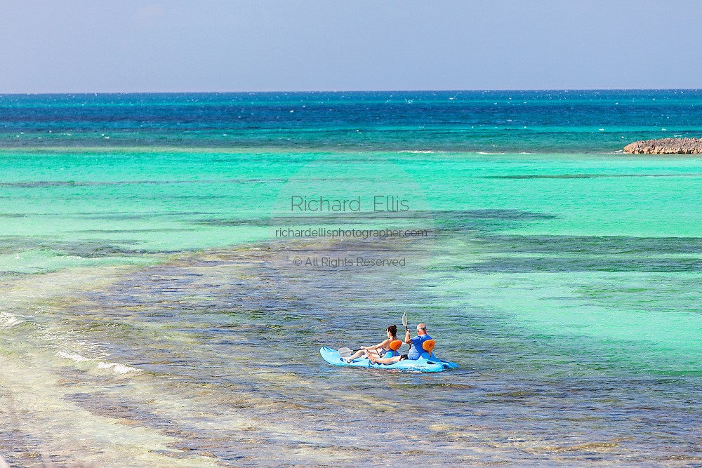 Kayakers explore along Bita Bay on Green Turtle Cay, Bahamas.