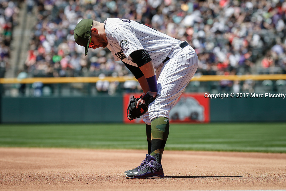 SHOT 5/28/17 1:00:36 PM - The Colorado Rockies Mark Reynolds #12 waits for a pitch against the St. Louis Cardinals during their regular season MLB game at Coors Field in Denver, Co. The Rockies won the game 8-4. (Photo by Marc Piscotty / © 2017)