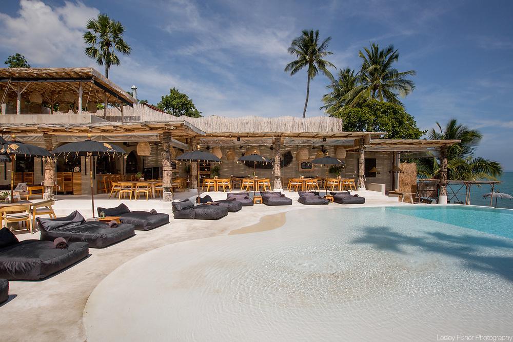 Swimming pool and restaurant at Karma Beach Resort, a unique resort located on Bophut Beach, Koh Samui, Thailand