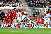 England Forward Wayne Rooney's free kick is blocked by Malta Defender Zach Muscat during the FIFA World Cup Qualifier match between England and Malta at Wembley Stadium, London, England on 8 October 2016. Photo by Andy Walter.