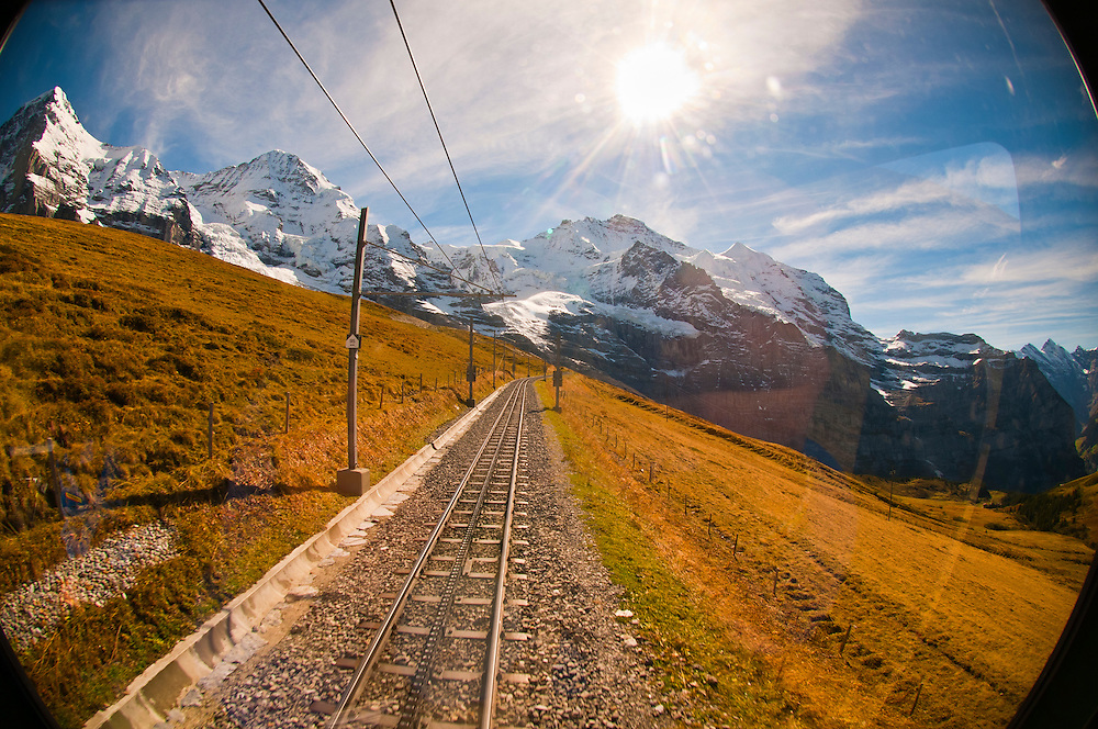 Jungfrau Railway train climbing from Kleine Scheidegg to Eigergletscher, Swiss Alps, Canton Bern, Switzerland
