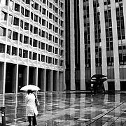 """A set on the business center of """"La Défense"""" and the strolling of its workers, Paris, France. Série sur les déambulations de personnages dans l'immensité du quartier de """"la Défense"""", Paris, France."""