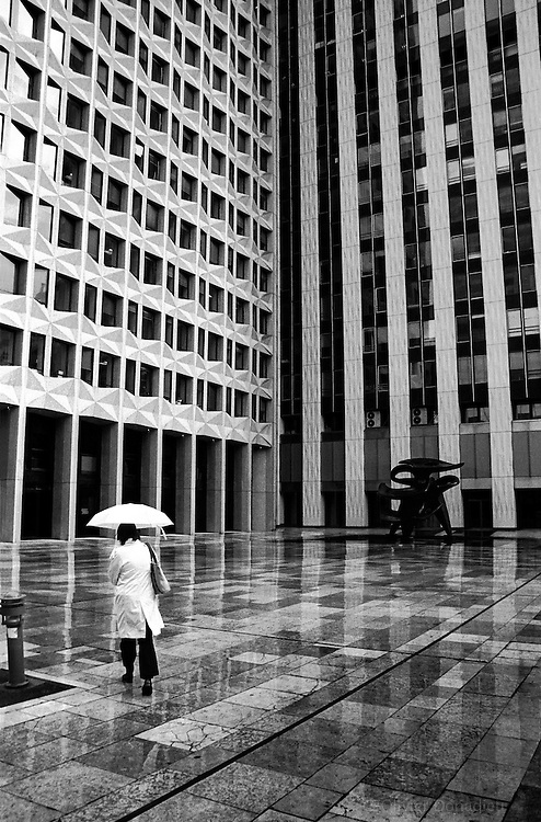 "A set on the business center of ""La Défense"" and the strolling of its workers, Paris, France. Série sur les déambulations de personnages dans l'immensité du quartier de ""la Défense"", Paris, France."