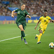 GRENOBLE, FRANCE June 18. Emily Gielnik #15 of Australia  defended by Deneisha Blackwood #14 of Jamaica during the Jamaica V Australia, Group C match at the FIFA Women's World Cup at Stade des Alpes on June 18th 2019 in Grenoble, France. (Photo by Tim Clayton/Corbis via Getty Images)