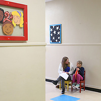 Lauren Wood | Buy at photos.djournal.com<br /> Volunteer Sherry Jenkins talks to second grader Alexis Lewis after she read a book about Olivia the Pig aloud Thursday morning at Joyner Elementary School.