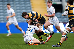 Sam Spink of Wasps U18 is tackled by Finn Marks of Exeter Chiefs U18 - Rogan Thomson/JMP - 16/02/2017 - RUGBY UNION - Sixways Stadium - Worcester, England - Wasps U18 v Exeter Chiefs U18 - Premiership Rugby Under 18 Academy Finals Day 3rd Place Play-Off.