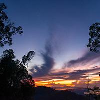 Beautiful sunset over Gunung Silam, Sabah, Malaysia, Borneo, South East Asia.