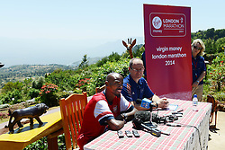 © London News Pictures. 30/01/2013. Iten, Kenya. VIRGIN MONEY LONDON MARATHON 2014 PREVIEW... Mo Farah, GB is asked questions by London Marathon race director Hugh Brasher, and members of the press about his upcoming marathon debut. The backdrop is The Kerio Valley, which forms part of The Rift Valley. Photo credit: Mike King/London Marathon/LNP