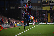 Wilfred Zaha with the control during the Barclays Premier League match between Crystal Palace and Swansea City at Selhurst Park, London, England on 28 December 2015. Photo by Michael Hulf.