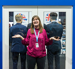 © Licensed to London News Pictures. 01/10/2019. Manchester, UK. A woman & three men attempt to block the view into the International Lounge after Armed Police were called to the International Lounge at the Conservative Conference today after an alleged incident in the area, the lounge & press room are now on lockdown. Third day of the Conservative Party Conference at Manchester Central in Manchester. Photo credit: Andrew McCaren/LNP