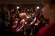New York, NY - July 05, 2013 : Luke Spring, 10, right, watches fellow students dance on stage during the Mini Jazz Class at the New York City Dance Alliance National Summer Workshop held at the Sheraton New York Times Square Hotel in New York, NY on  July 05, 2013. Luke Spring, a dance prodigy from Studio Bleu Dance Center in Ashburn, VA, has performed on the Tonys, Ellen, So You Think You Can Dance and The Ford Gala. His sisters Cami Spring, 20, and Lucy Spring, 18, are both award winning dancers. (Photo by Melanie Burford/Prime for The Washington Post)