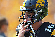 August 31 2013: Iowa Hawkeyes quarterback Jake Rudock (15) licks his fingers as he warms up before the start of the NCAA football game between the Northern Illinois Huskies and the Iowa Hawkeyes at Kinnick Stadium in Iowa City, Iowa on August 31, 2013. Northern Illinois defeated Iowa 30-27.