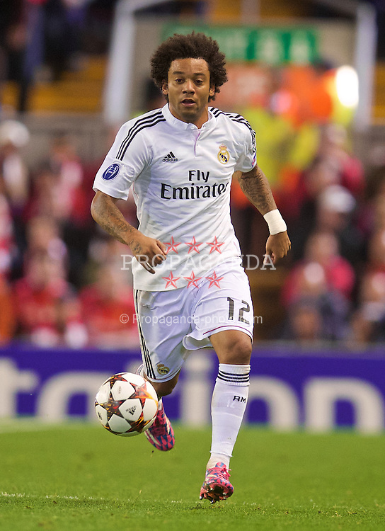 LIVERPOOL, ENGLAND - Wednesday, October 22, 2014: Real Madrid CF's Marcelo in action against Liverpool during the UEFA Champions League Group B match at Anfield. (Pic by David Rawcliffe/Propaganda)