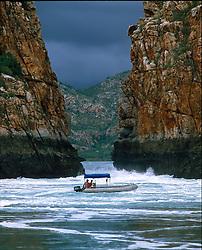 The Horizontal Waterfalls dwarfs an aluminium tender in full flood in the Kimberley wet season.
