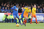 Christian Toonga of AFC Wimbledon on his first full debut beats Luke O'Nein of Wycombe Wanderers during the Sky Bet League 2 match between AFC Wimbledon and Wycombe Wanderers at the Cherry Red Records Stadium, Kingston, England on 21 November 2015. Photo by Stuart Butcher.