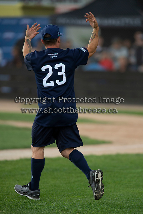 KELOWNA, CANADA - JUNE 28: Juno Award winning country music artist Aaron Pritchett motions the crowd after being introduced during the opening charity game of the Home Base Slo-Pitch Tournament fundraiser for the Kelowna General Hospital Foundation JoeAnna's House on June 28, 2019 at Elk's Stadium in Kelowna, British Columbia, Canada.  (Photo by Marissa Baecker/Shoot the Breeze)