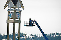 JEROME A. POLLOS/Press..A worker elevates toward the face of the clock tower Friday afternoon in downtown Coeur d'Alene.