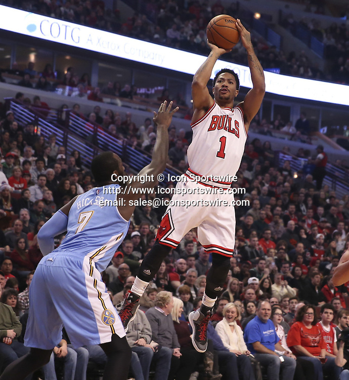 Jan. 1, 2015 - Chicago, IL, USA - Chicago Bulls guard Derrick Rose (1) takes a shot over Denver Nuggets center J.J. Hickson (7) during the first half of their game on Thursday, Jan. 1, 2015 at the United Center in Chicago. The Bulls won 106-101