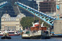 © Licensed to London News Pictures. 26/09/2015. London. Historic paddlesteamer Waverley has started her 2015 Thames season. The popular heritage vessel which hails from Glasgow, Scotland, was seen this morning in beautiful sunshine at Tower Bridge heading down river for the first full day of her Thames season. Waverley is marking the 40th anniversary of her preservation. Credit : Rob Powell/LNP